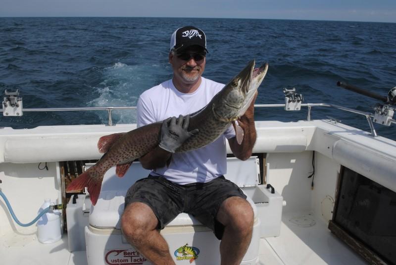 Mark Olschanski shows off a nice Lake St. Clair muskie.