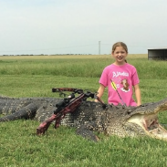 Ella Hawk landed a perfect shot on this 800-pound alligator, saving her guide from having to pull the animal from the river's murky depths.