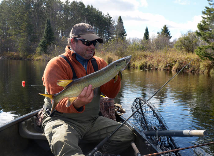 John Maier caught this 30-inch muskie on a stickbait on a river near Hayward, Wisconsin.