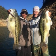 Paul Bailey (left) with his potential world record spotted bass.