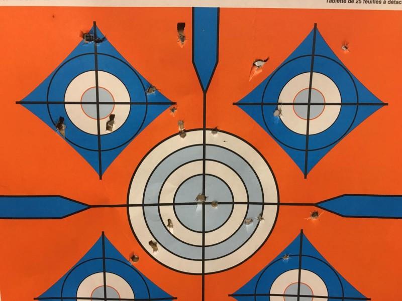 A target peppered with three buckshot Minishells at 10-yards range.