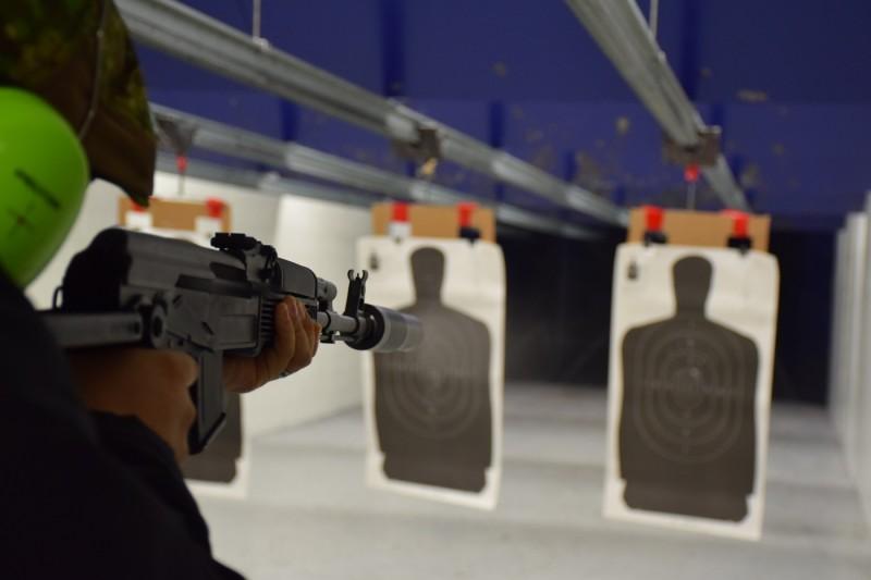 Nick Chen shooting a suppressed SAM7 underdfolder.