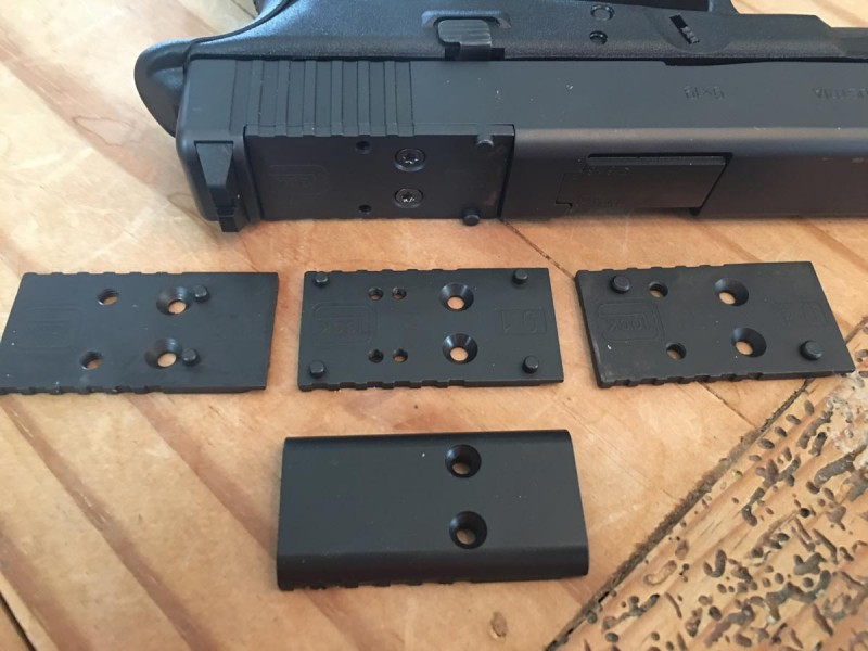 Four different mounting plates are in the box to fit a variety of optics.