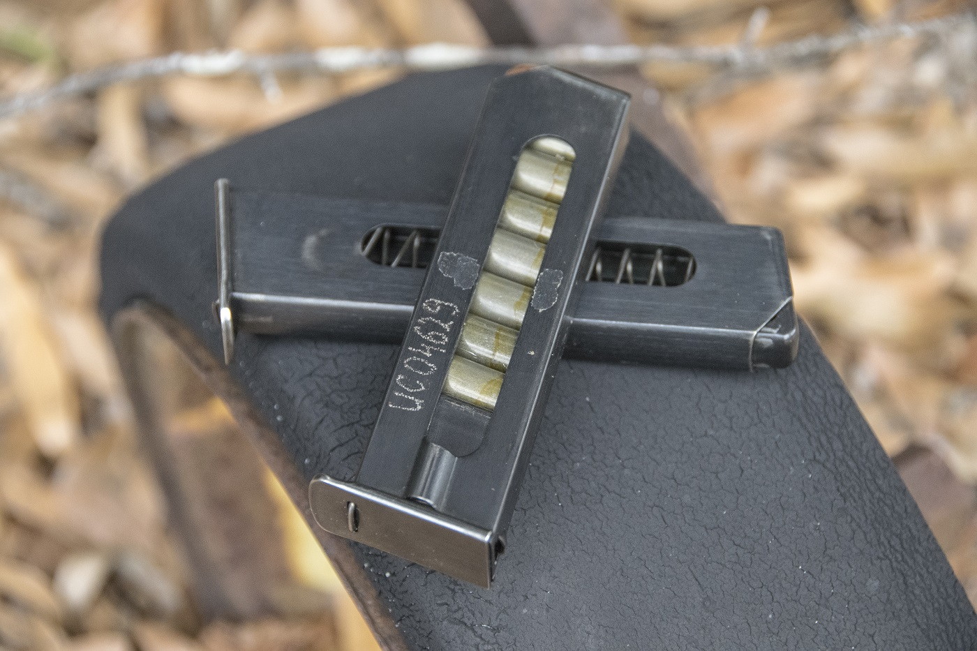 The wanad s narrow magazines hold eight rounds and feature windowed