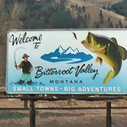 Fly fishing with a plug? This billboard was spotted along a road north of Lolo.