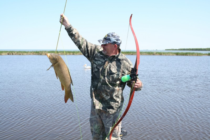 Central Manitoba is flat and covered with large, shallow lakes. It's perfect carp habitat. Combining a bear hunt with a bowfishing adventure in this area is a no-brainer.