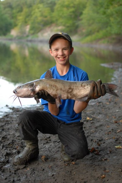 The author's 13-year-old son, Elliott, loves to fish the riverbank for channel cats.
