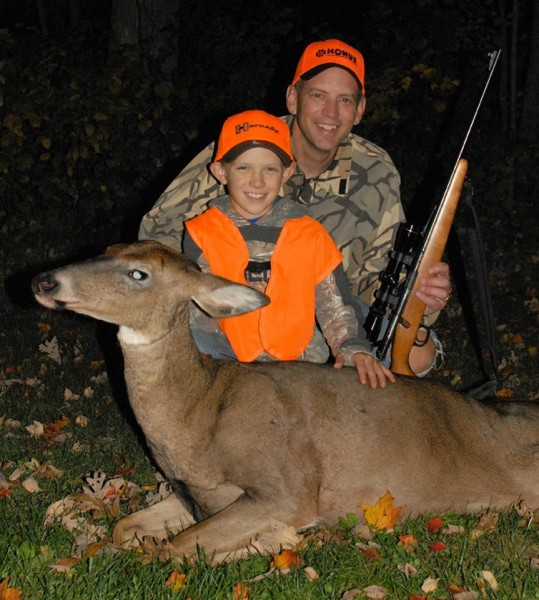 The author's youngest son, Luke, was all smiles after tagging his first whitetail, a mature doe on public land in Wisconsin.