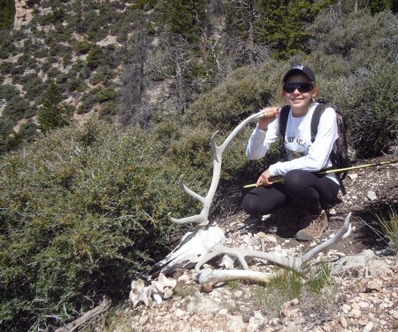 The author's daughter, Katelyn, descended down near-vertical terrain to investigate the remains of an elk in the backcountry of Wyoming. Choosing the proper hiking boot made the descent a success.