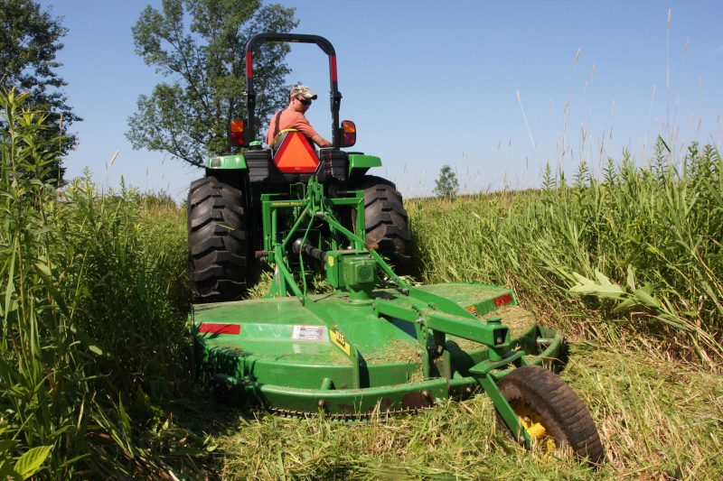 A rotary cutter takes tall grasses and other plants down to size.