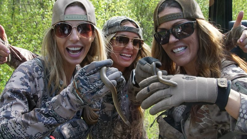 Three amigos (Julie, Kristy and Jana) with two rubber boas.