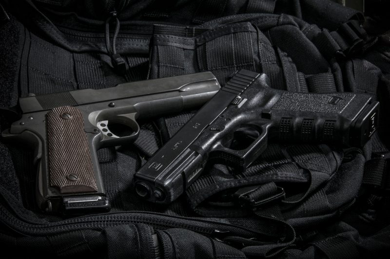Yesterday and today: The .45 ACP 1911 sits alongside a Glock model 17 in 9mm. The Glock's magazine holds nearly three times as much ammunition.