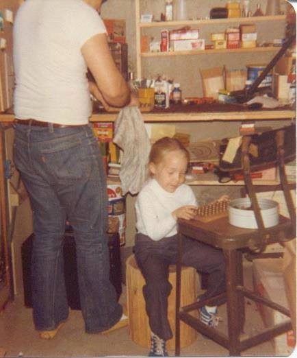 Niki loading ammo with her dad at age 3.