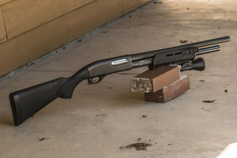 The author's Remington 870 pawn shop find with reduced length-of-pull stock, Magpul forearm, shorter barrel and Streamlight tactical light – an inexpensive but effective home-defense shotgun.