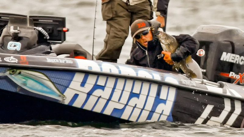 Just how big are Mille Lacs smallmouth? Because Bassmaster Elite anglers can't use landing nets, sometimes the best way to get a giant smallie in the boat is with a bear hug. Shown here is eventual Mille Lacs champion Seth Feider with a big fish from the first day. (Image by Bassmaster photographer James Overstreet)