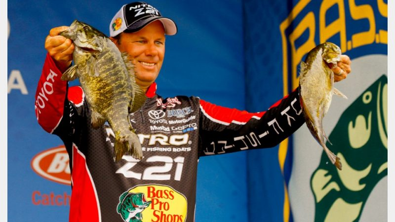 Kevin VanDam with two big smallmouth caught on the final day of the event (photo by James Overstreet/Bassmaster)