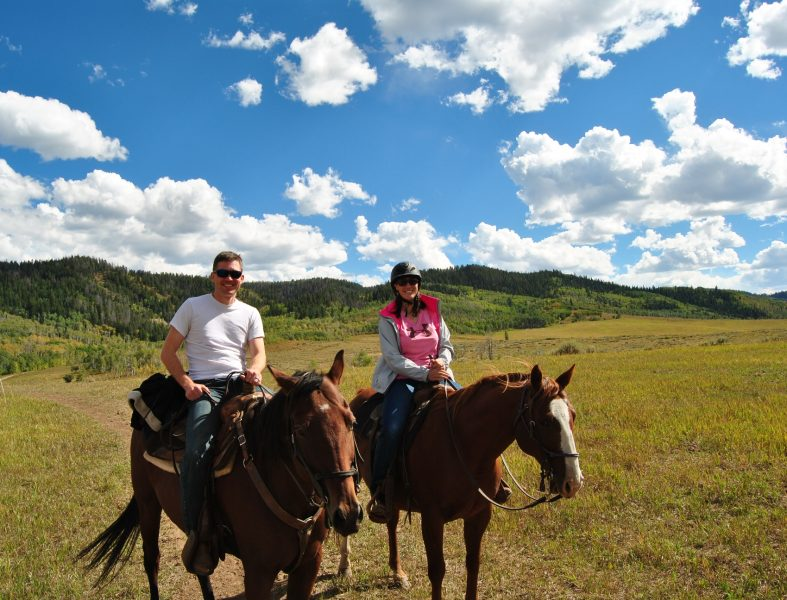 Horseback riding in the high meadow.