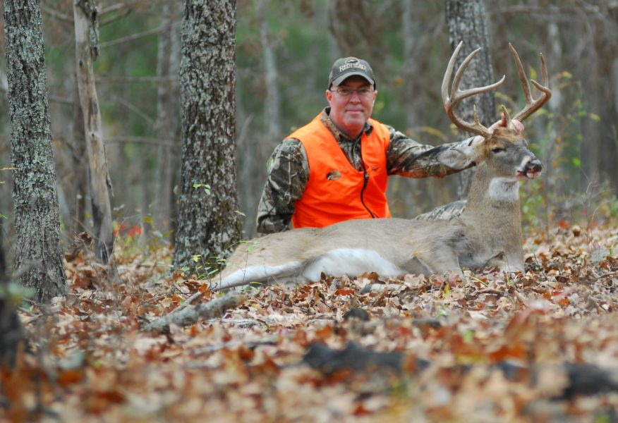 The author with a mature rutting buck taken from a Redneck Blind.