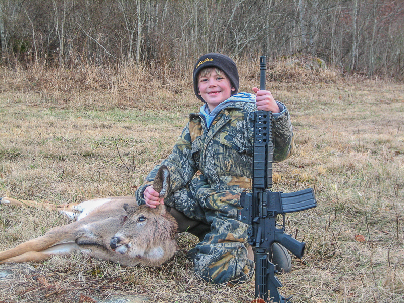 Like father, like son. ARs with adjustable stocks fit small-framed shooters very well.