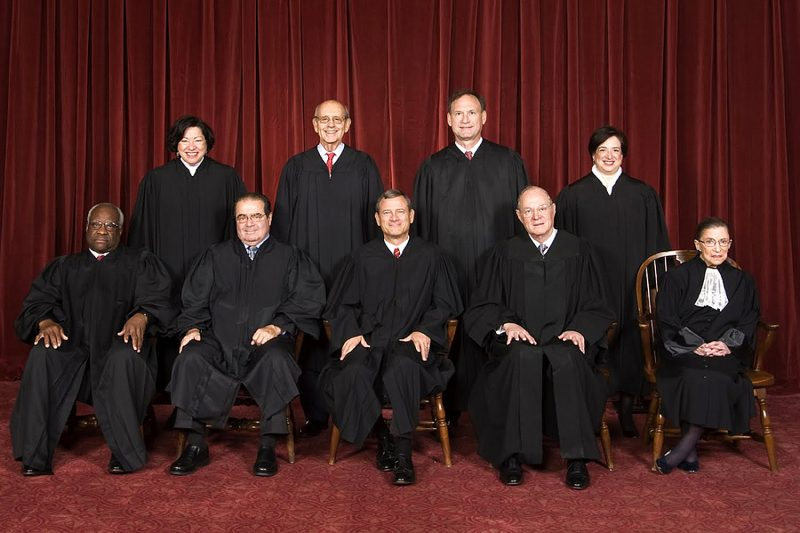 The Roberts Court, 2010. Back row (left to right): Sonia Sotomayor, Stephen Breyer, Samuel Alito, and Elena Kagan. Front row (left to right): Clarence Thomas, Antonin Scalia, Chief Justice John Roberts, Anthony Kennedy, and Ruth Bader Ginsburg. Note: There are eight justices because Antonin Scalia died on February 13, 2016 at the age of 79. The next President of the United States will nominate someone to fill the Court vacancy, then the Senate will vote (simple majority) to confirm the nominee. This nomination/confirmation system is in place so both the Executive and Legislative branches of the federal government have a voice in the composition of the Supreme Court. (Image from Wikimedia Commons)