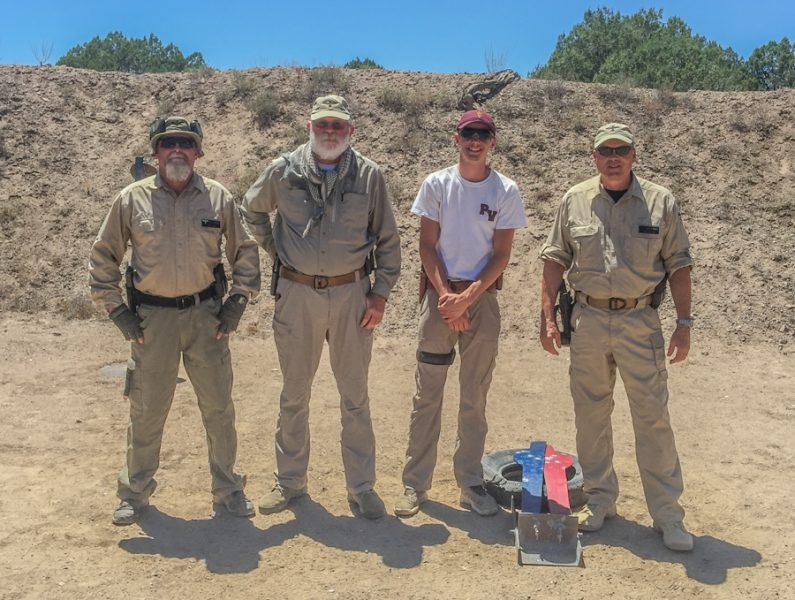 The author's son, with his instructors, after winning the shoot-off.