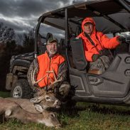 The author and his father, Glen, with a late-season buck they called Early Bird.
