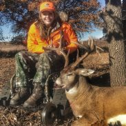 Ashlee with a huge Oklahoma buck taken while hunting with Mossy Oak at Canadian River Hilton Hunting Lodge.
