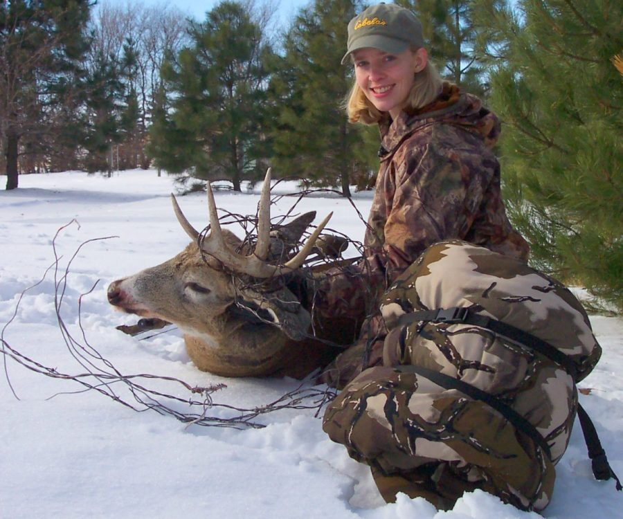 "The author's wife, Jodi, arrowed this ""barbed wire"" buck on a cold December day after waiting comfortably in a Heater Body Suit for 3 hours."