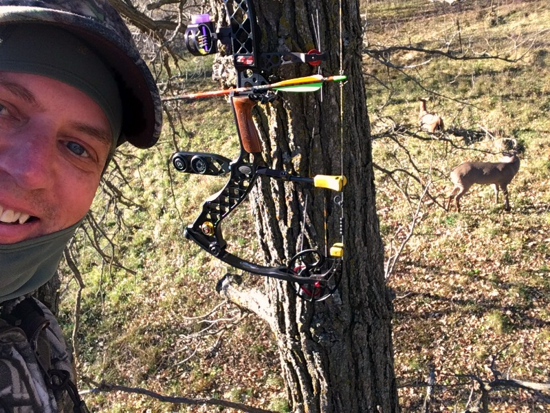 Treestand selfie thanks to a charged smartphone. See the buck in the background? He's checking out a doe decoy.