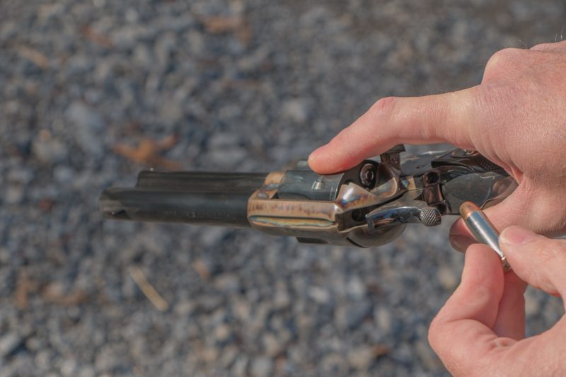 With practice, loading a single action while keeping it in your shooting hand is easy; rotate the cylinder with your trigger finger and insert the cartridges with your support hand.