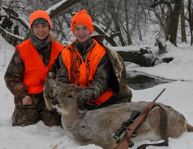 The author's son, Elliott, and wife, Jodi, with the young hunter's Christmas Eve whitetail.