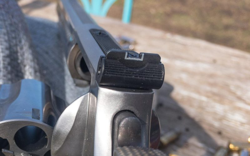 The front sight is a serrated ramp with a red insert for visibility while the rear is adjustable for windage and elevation.
