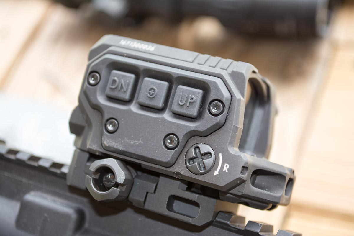 The center button is the on-off switch and also switched between the single and four-dot reticles. The other two raise and lower dot intensity.