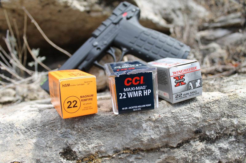 22 Magnum ammo with the Kel-Tec PMR-30 in background
