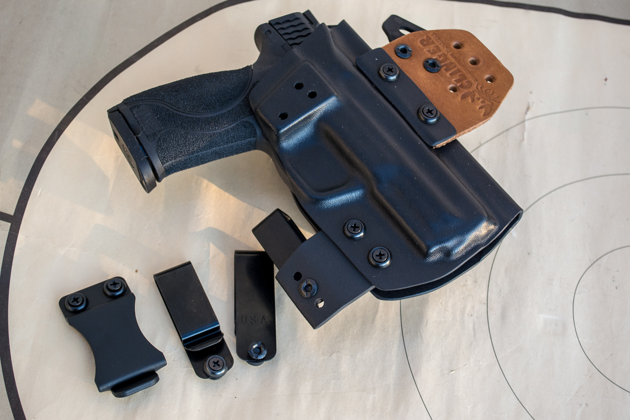 After trying just about everything, I've settled on inside the waistband holsters like this Clinger No Print Wonder and similar models.