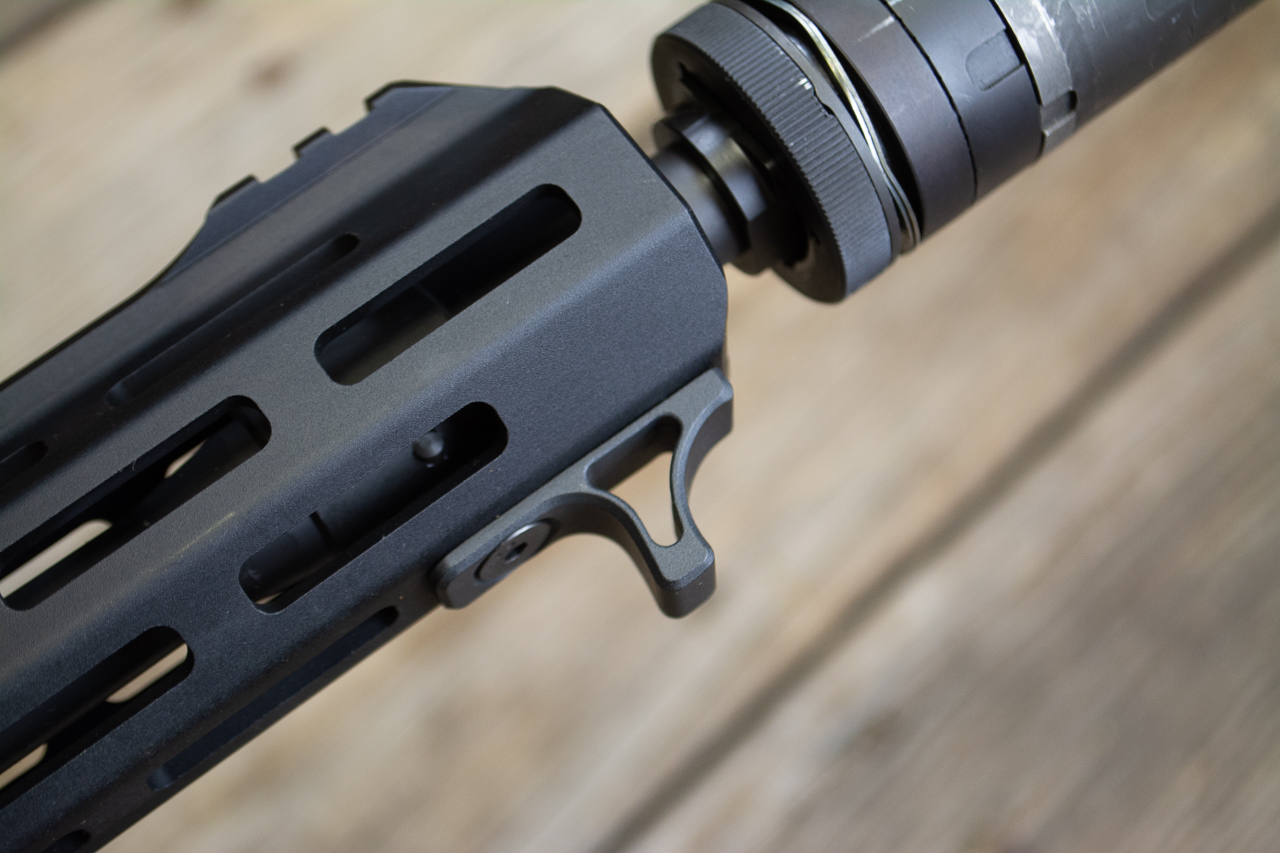 The handguard is surrounded by M-LOK slots. One is used for the hand stop.