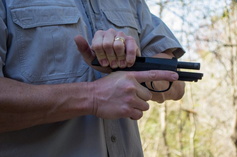 Will you have both hands available to draw your handgun and rack the slide?