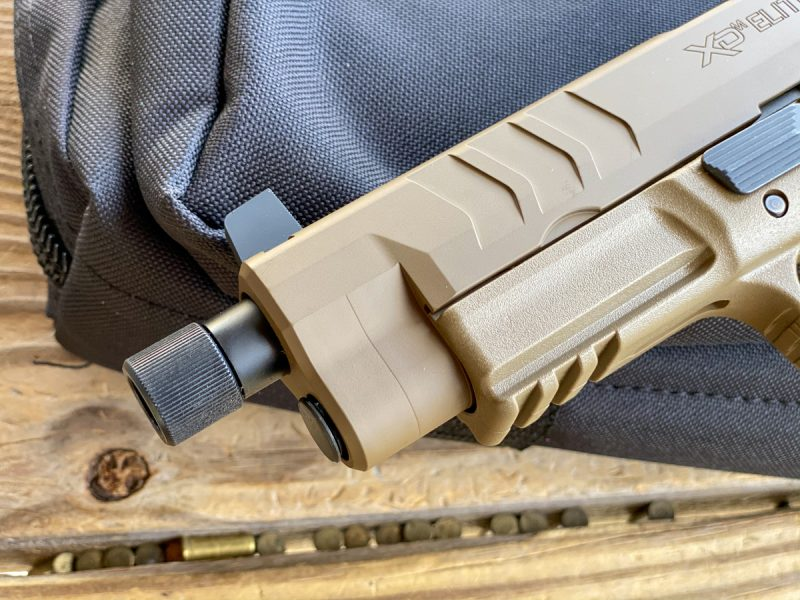 Note the enlarged slide serration pattern. The Tactical OSP model also features a threaded barrel.